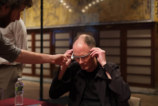 William Gibson tries on a pair of Google Glasses. Photo by Joe Kendall.