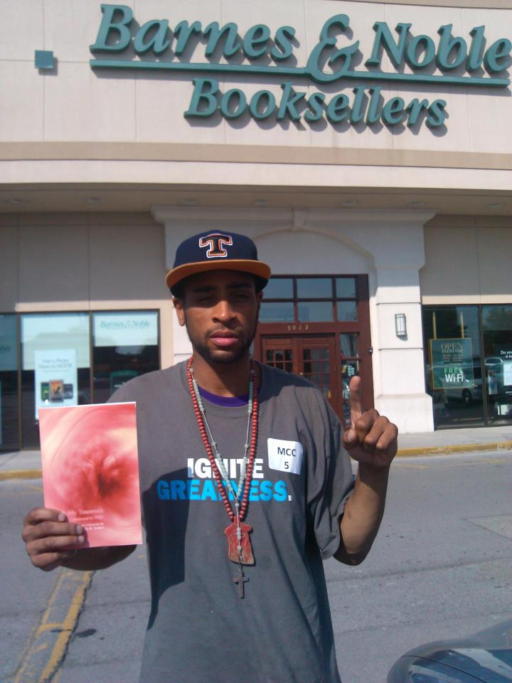 Myles holding his book outside Barnes & Noble.