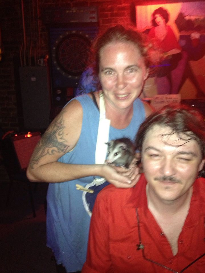 The life of a bluesman. Worley with a fan and a baby possum.