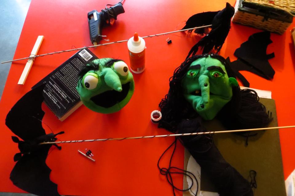 The simple bat/raven puppets are shown with the early stages of the Witch Sister hand puppets.