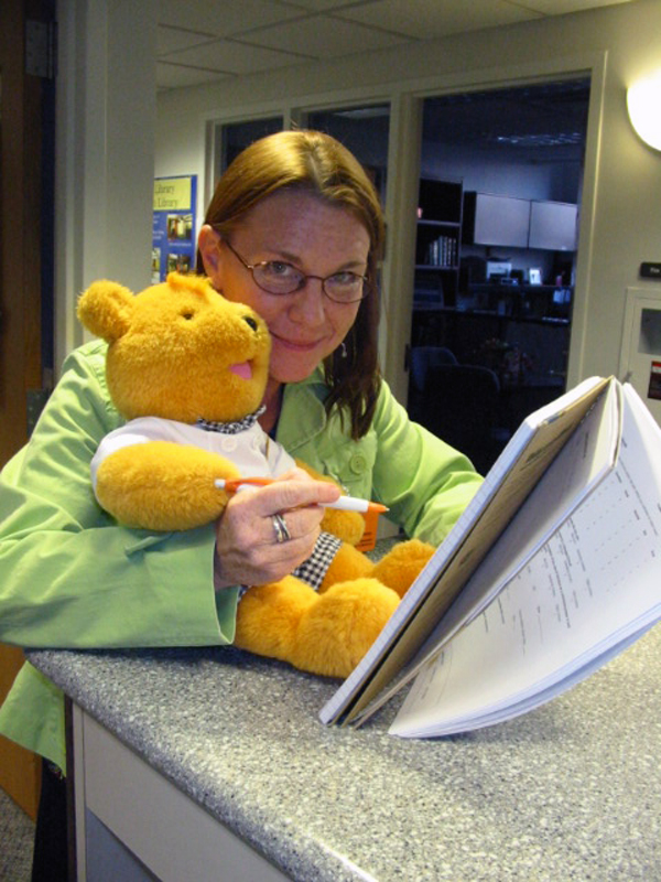 Donna Doyle and Chemo Bear prepare to launch Literary Rounds during National Poetry Month in 2012. Photo by Rachel Belcher.
