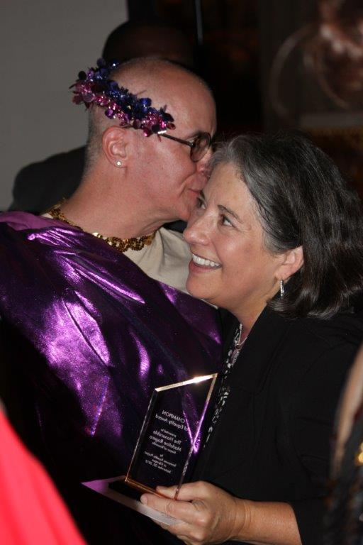 Gary Elgin congratulates Knoxville's Mayor Rogero for her Champions of Equality Award at a TEP Olympus Awards event.