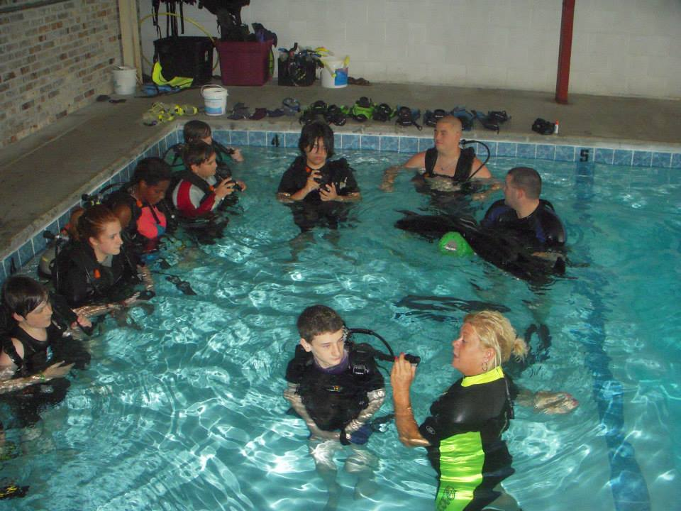 Gear instruction in the pool. Photo from Ski/Scuba Center's Facebook page.