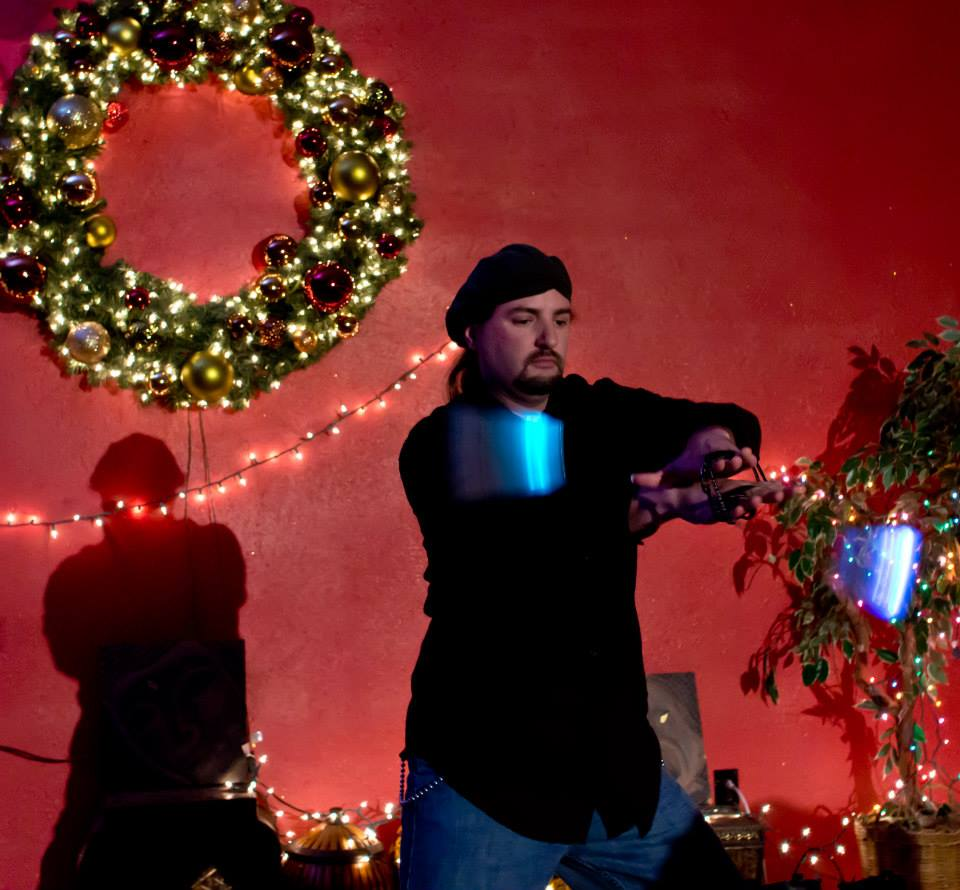 Russell Ultima Flynn practices with LED poi. Photo by Sharon Mansoor.