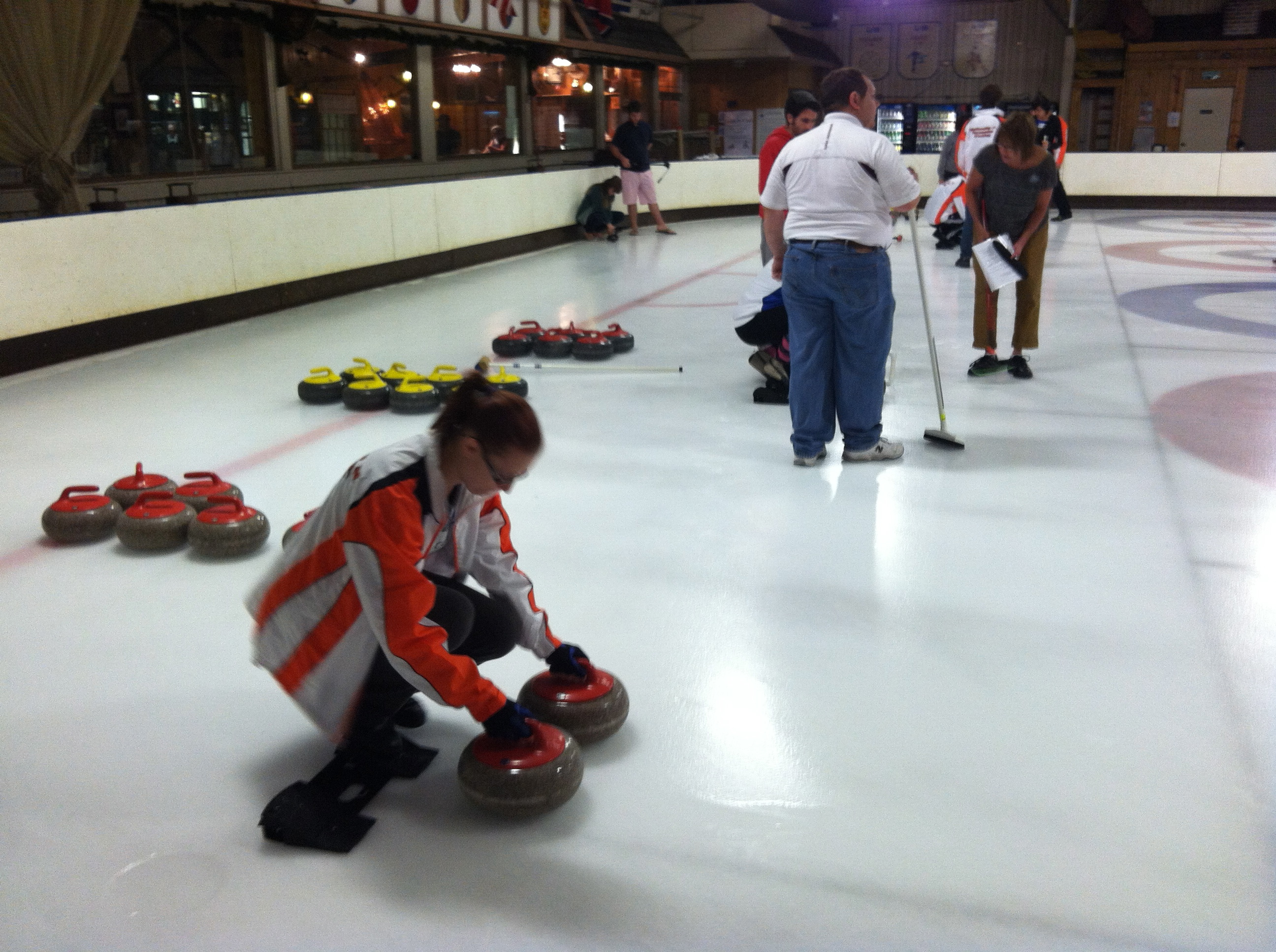 Carole sets up the curling stones.