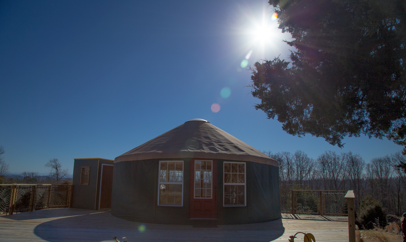 The yurt with a separate bathroom nearby.