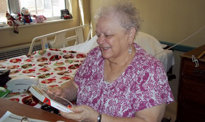A resident receives a book.