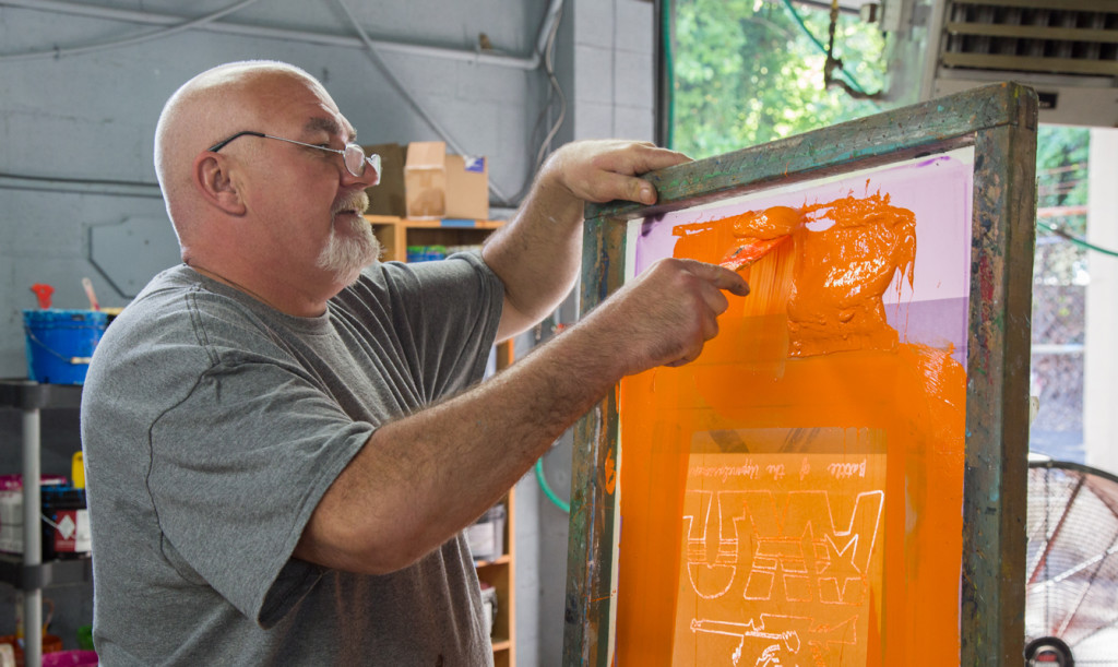 Donnie Rogers works on a t-shirt for a UT club.