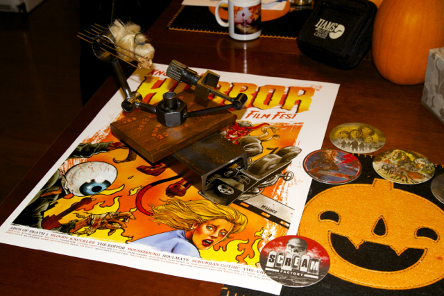 Paulk & Co. trophey, festival poster, and coasters.