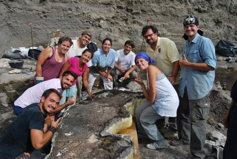 The crew is about to flip a large fresco fragment.