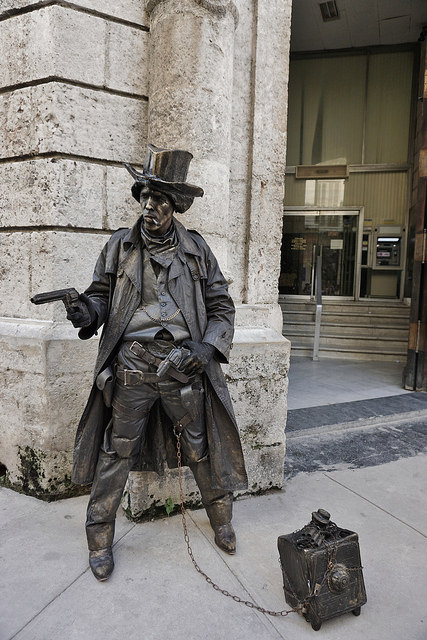 """This """"statue"""" is a street performer."""