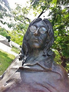 John Lennon statue with real glasses.