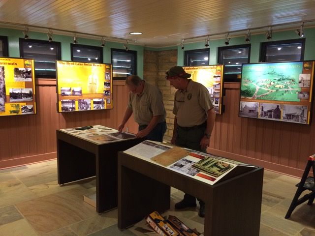 Ward Weems (left) and Jeff Wells (right) of Tennessee State Park's Interpretive and Education Section assemble a display for Cumberland Mountain State Park's new exhibit.