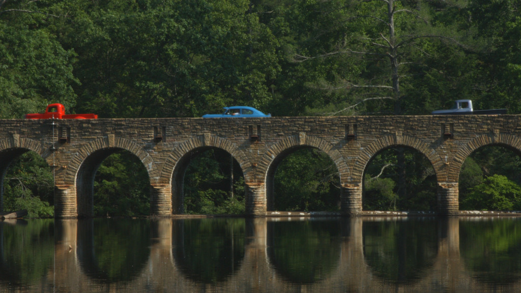 The Crossville Cruisers cross Byrd Creek Dam, the largest masonry structure ever built by the Civilian Conservation Corps.