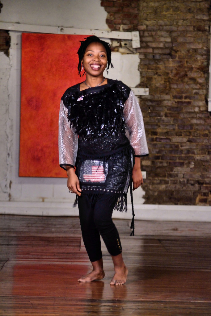 Hara Ware models artist Judi Gaston's upcycled clothes made from trash.
