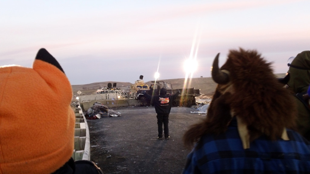"""""""After a violent night, veterans and  water protectors formed lines to shield civilians from vicious assault."""""""