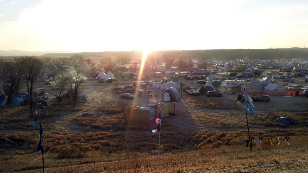 "Campsites at Standing Rock. ""Here with the many flags flying,"" says Runge, ""I always felt resolute in what I was doing, even if I just wrapped in the shadow of all these flags that have come together to fight the ""black snake"" [the pipeline]."